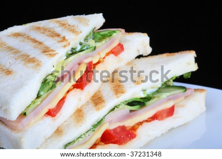 Toast with vegetables and ham