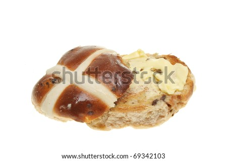 Toasted and buttered hot cross bun isolated on white