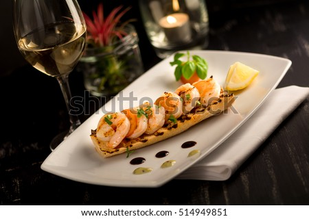toasted bread foccacia bruschetta with cooked prawn shrimp butter lemon white wine
