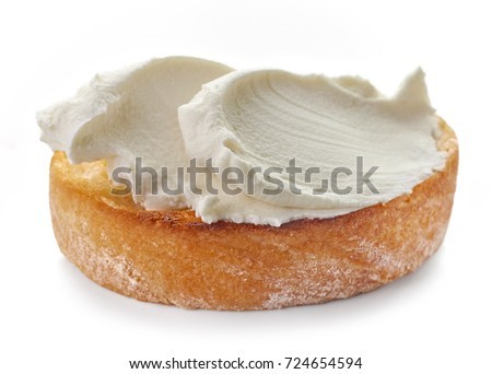 toasted bread with cream cheese isolated on white background, selective focus