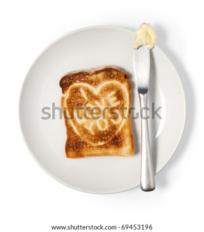 Toasted bread with love message on plate. Isolated on white, Clipping path.