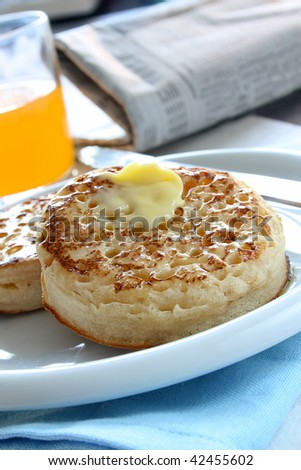 Toasted butter crumpets on a plate