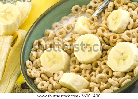 Toasted oat cereal with sliced bananas in a bowl macro
