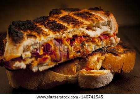 Toasted  sandwich. Toasted cheese, tomato and onion sandwich done on the BBQ.