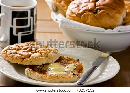 Toasted Teacakes. Toasted fruit bread buns with raisins, currants, sultanas, melted butter and a large mug of tea.