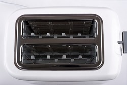Toaster with two compartments for roasting bread at the same time. Close up. Top view.