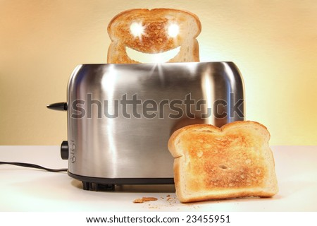 Toaster with two slices of bread on kitchen counter