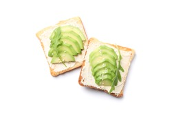 Toasts with butter, avocado, arugula and sesame isolated on white background