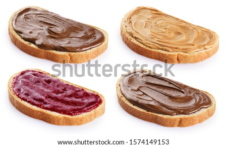 Toasts with chocolate butter, peanut butter and  berry jam isolated on white background. With clipping path.