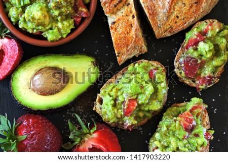 Toasts with guacamole. Avocado Strawberry Toast. Healthy diet snack. Keto toasts Keto diet. #1417903220