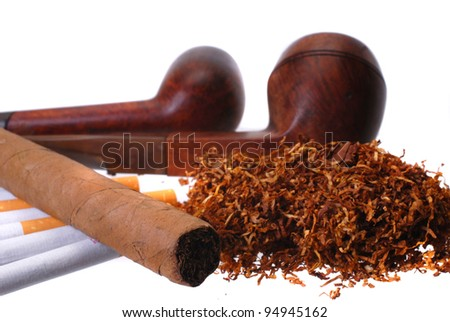 Tobacco. Cigar, cigarettes, pipes and a handfull of tobacco