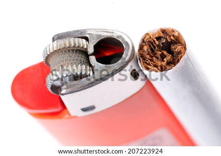 Tobacco in cigarettes and lighter close up on white background