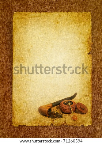 Tobacco pipe, snuffbox and tobacco accessory. Vintage paper background on the brown leather texture.
