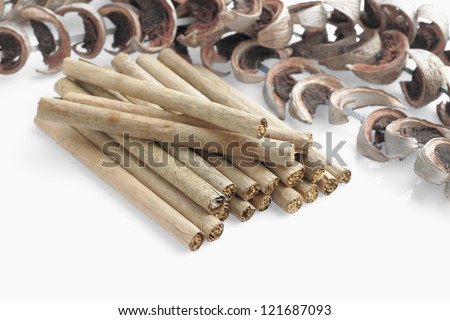 tobacco with dry banana leaf rolls and betal nut fruit