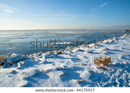 Toboggan on winter coast - stock photo