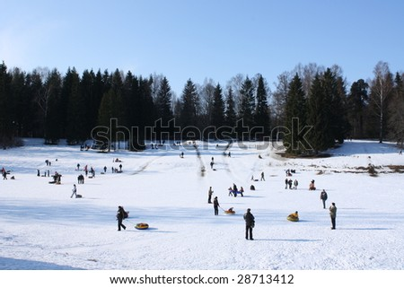 tobogganing hillock and crowd