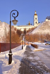 Tobolsk Kremlin in winter. A staircase from the Lower Town leads to a medieval fortress with a high bell tower. Old Russian architecture of the XVII century in the first capital of Siberia