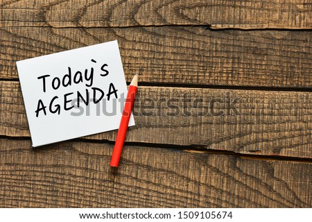 Today`s agenda text on wooden background Stock photo ©
