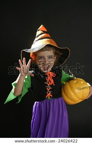 Toddler beautiful witch girl wearing halloween costume and make up - stock photo
