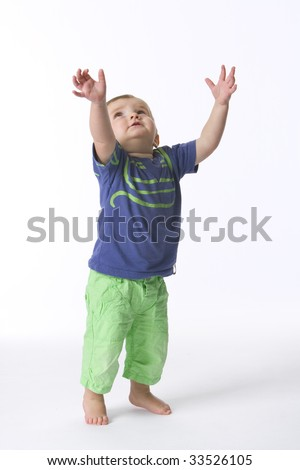 Toddler boy reaching out with his hands
