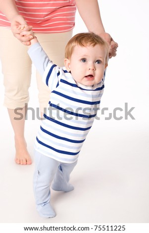 Toddler boy trying to make a step