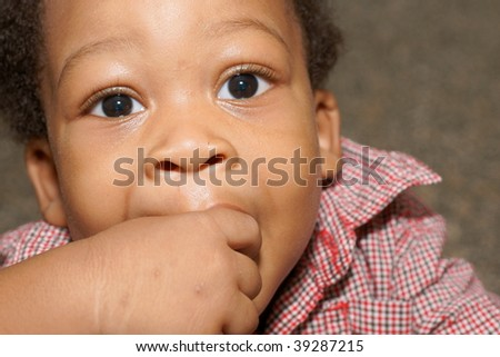 toddler boy with fingers in mouth