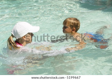 Toddler child taking swimming lessons