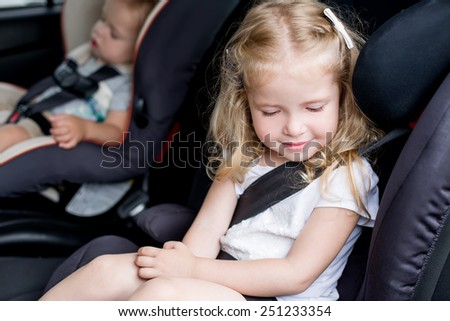 Toddler cute kids in car seats summer