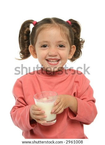 Toddler enjoying a glass of fresh milk