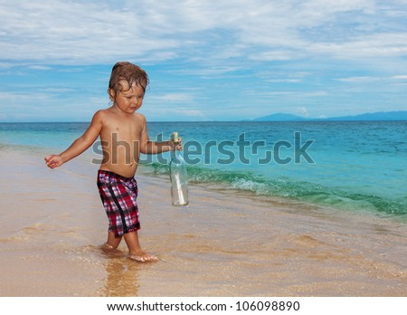 toddler found sos bottle walking on the beach
