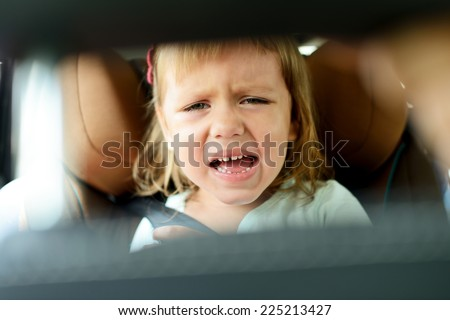 toddler girl crying in car
