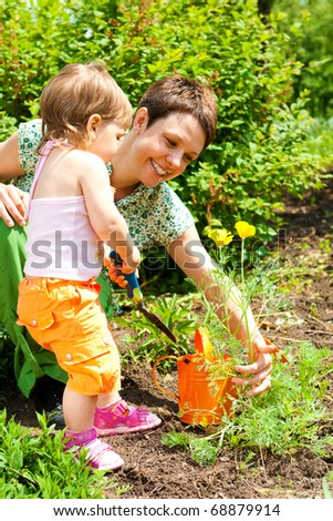 Toddler girl enjoying time in the garden