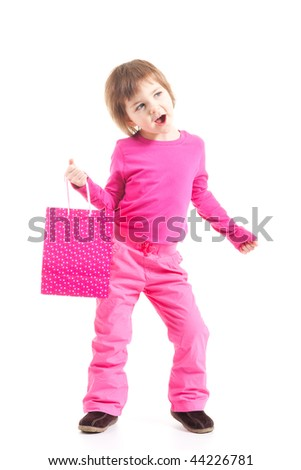 Toddler girl in pink outfit holding gift bag