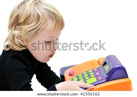 toddler girl playing with cash register over white.