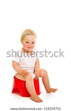 Toddler girl potty trainting isolated on white