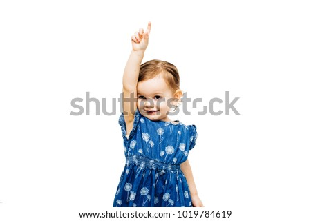 toddler girl raising hand and pointing up