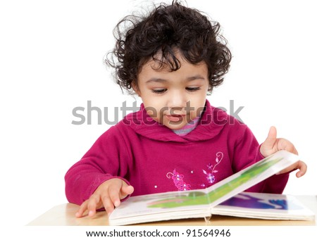 Toddler Girl Reading a Picture Book, Isolated, White