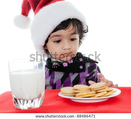 Toddler Girl Trying to Eat Santa's Cookies and Milk, Isolated, White