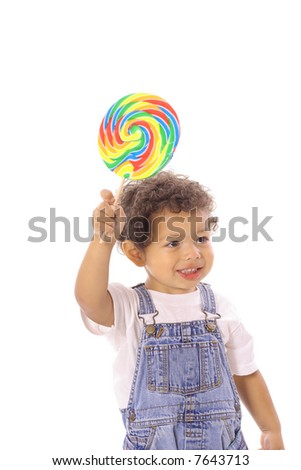 toddler holding up a lollipop