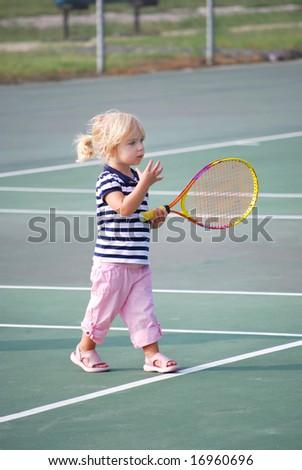 toddler learning tennis