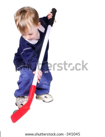 toddler playing hockey