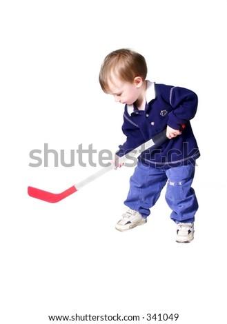 toddler playing hockey