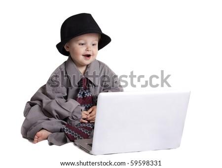 toddler playing on laptop