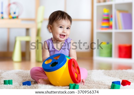 Toddler playing with a shape sorter