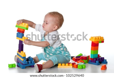 toddler playing with educational blocks