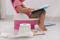 Toddler potty training. reading books on the toilet.