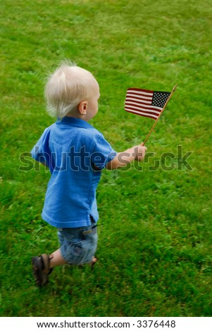 Toddler running around waving an American flag