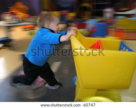 Toddler running with cart