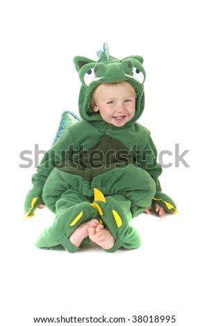 Toddler wears a cute dragon costume. Halloween Theme