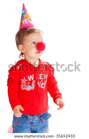 Toddler with a funny nose and birthday hat on